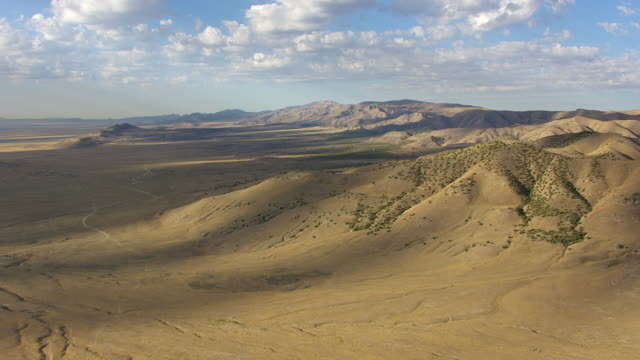 WS AERIAL View over hills southwest of Great Salt lake en route from Salt lake city to Bonneville / Utah, United States