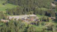 WS AERIAL View over houses in e alta ski hill road / Wyoming, United States