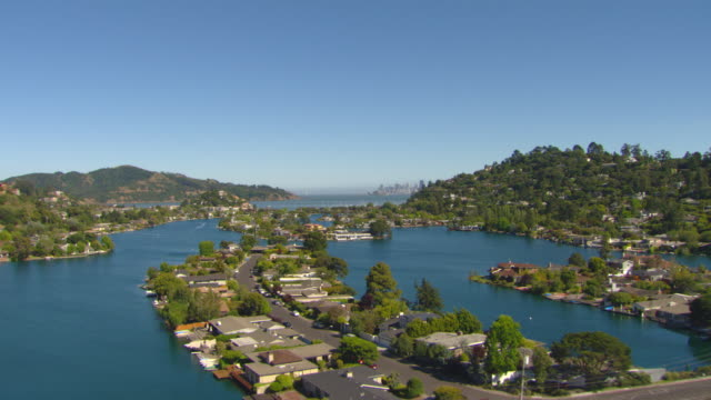 WS AERIAL View over houses located on water inlets and approaching downtown / Tiburon, California, United States