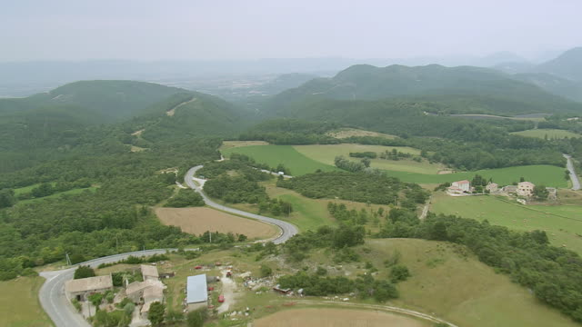 WS AERIAL View over Landscape and road near Aleyrac / Rhone Alpes, France