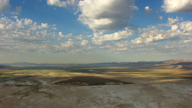 WS AERIAL View over landscape southwest of Great Salt lake en route from Salt lake city to Bonneville Salt Flats / Utah, United States