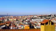 View over Lisbon city with 25 de abril bridge in the background.