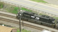 MS TS ZO AERIAL View over NS train traveling on tracks / Matewan, West Virginia, United States