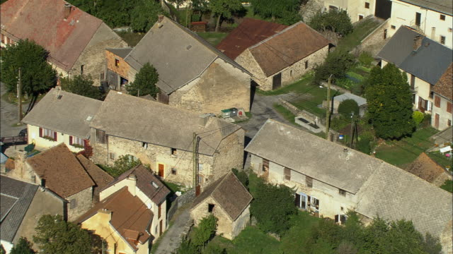 AERIAL WS View over old stone houses in French town / Rhone-Alpes, France