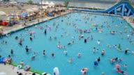 WS AERIAL View over people enjoying at Hangang River outdoor pool / Seoul, South Korea
