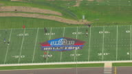 MS DS ZO AERIAL View over people playing on football field with highway and surrounding area at Pro Football Hall of Fame / Canton, Ohio, United States