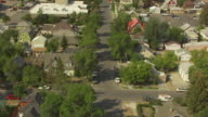 WS AERIAL View over residential street with trees / Livingston, Montana, United States