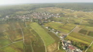 WS AERIAL View over small town an farm fields with busy roads / Champagne Ardenne, Italy