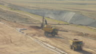MS AERIAL View over tractor scooping earth at Golden Sunlight Mine in Jefferson County / Montana, United States
