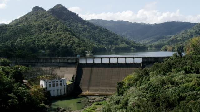 WS TU AERIAL POV View over trees to hydroelectric plant at Lago Dos Bocas / Arecibo, Puerto Rico, United States