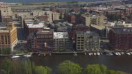WS AERIAL TS View over Water Street in warehouse district of Third Ward and over Milwaukee River / Milwaukee, Wisconsin, United States
