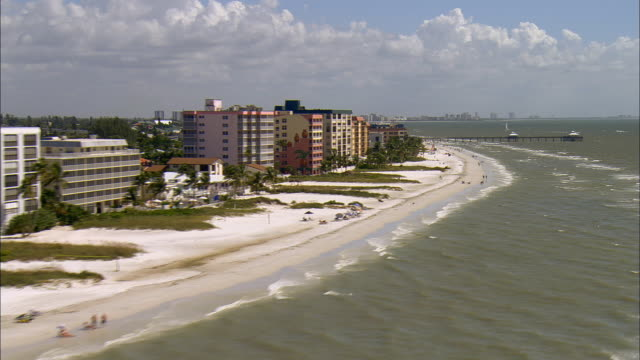 AERIAL WS View past beach and hotels along Gulf coast / Fort Myers Beach, Florida, USA