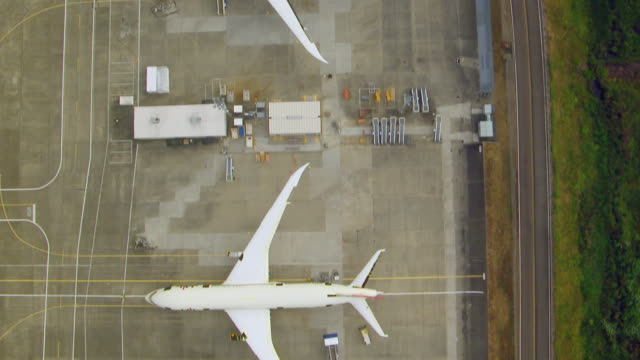WS AERIAL View row of airplanes outside at Boeing Everett factory / Everett, Washington, United States
