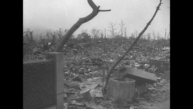 blocks of devastation in Hiroshima in aftermath of US atomic bombing in World War II rubble and debris river to the left / buildings stand beyond...