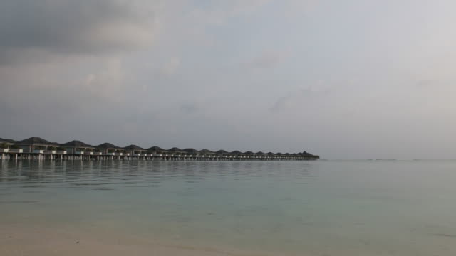 View to overwater bungalows and calm lagoon