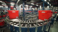 Views of a semiautomated production line in a packing factory