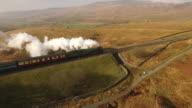 Views of a steam train moving through Cumbria