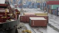 Views of cranes destroyed by Saudi Arabian airstrikes at a major port in Yemen