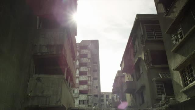 Views of derelict buildings on abandoned Hashima Island