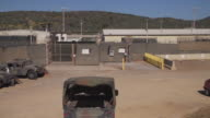 Views of Guantanamo Bay prison and security fences
