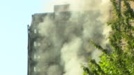 Views of smoke rising from the Grenfell Tower fire