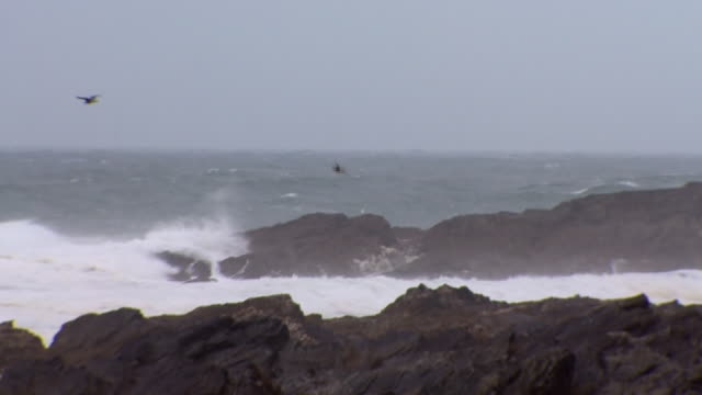 Views of stormy conditions along the coast of Newquay