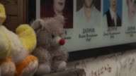 Views of stuffed toys alongside names and photographs of victims at the scene of the Beslan school siege