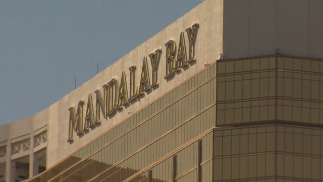 Views of the police cordon and smashed windows at the Mandalay Bay hotel in Las Vegas after a mass shooting incident at a concert