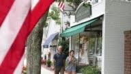 Views of the Ralph Lauren shop in Southampton NY July 23 2017 Photographer Timothy Fadek Shots pan left over pedestrians walking by Ralph Lauren and...