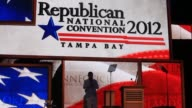 Views of the stage of the Republican National Convention in Tampa as workers set up / Views of large nets of balloons inside stadium / Close on the...