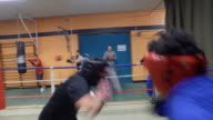 Views of two boxers sparring
