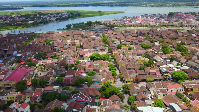 Views over Hoi An's famous Ancient Town. Red rooftops line the city skyline.