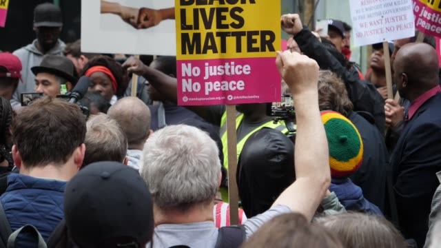 A vigil has been held outside a London police station for a young father who died after being chased by officers Relatives and friends of Rashan...