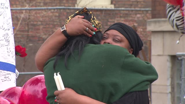 A vigil was held on Chicago's South Side near the spot where the Rapper Mario Hess known as 'Big Glo' and 'Blood Money' was shot 10 times Hess was...