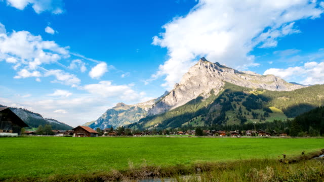 Village in Jungfrau valley with Swiss Alps Time Lapse - Stock Video - Stock Video