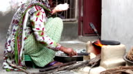 Village Women Cooking Food on Mud Stove at Home