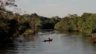 Villagers aboard river skiffs, Peruvian Amazon, Peru