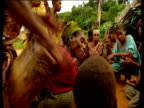 Villagers of Mokoko Babongo village sing and dance wearing traditional dress of leaves Mokoko Gabon