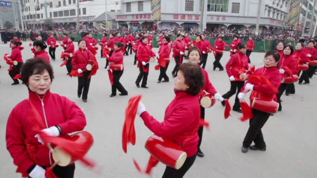 MS Villagers performing with gong and drum in traditional festive folk celebration or carnival during chinese spring festival  AUDIO  / xi'an, shaanxi, china
