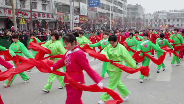 MS TD Villagers performing yangko dance in traditional festive folk celebration or carnival during chinese spring festival  AUDIO  / xi'an, shaanxi, china