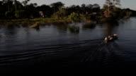 Villages and river skiffs, Peruvian Amazon, Peru