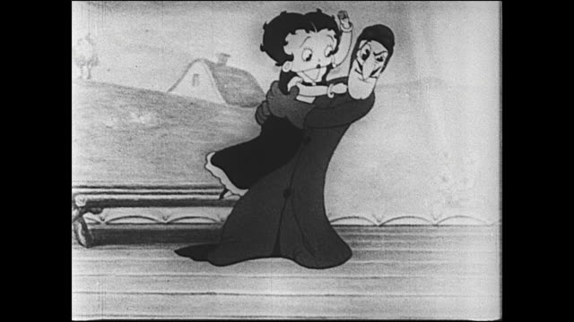 Villain picks up Betty Boop and attempts to steal her as she tries to fight him off