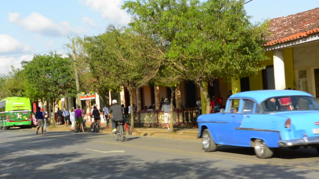 Vinales Cuba with Main Square traffic on Main Street and busy small town