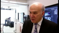 Vince Cable announces investment in digital industry during Shoreditch visit ENGLAND London Shoreditch Holition INT Vince Cable MP being shown new...