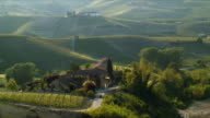 WS HA Vineyards and winding road rural landscape, Piedmont, Italy