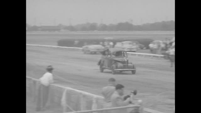 VS vintage cars in various stages of wreckage drive halfway on ramp turn over roll crash to a stop one just breaks the ramp and does not flip most...