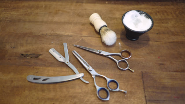 Vintage equipment of a barber on a wooden table