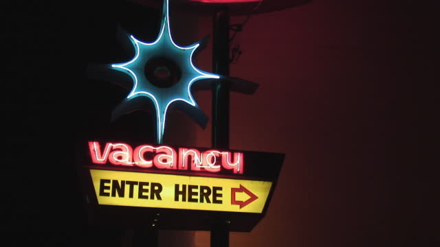 MS, Vintage motel vacancy sign illuminated at night, California, USA