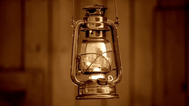 vintage oil lamp rocking (sepia toned / wild west style)