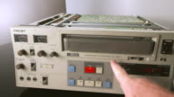 MS Vintage  three quarter inch video cassette being loaded into sonny u matic professional video recorder player